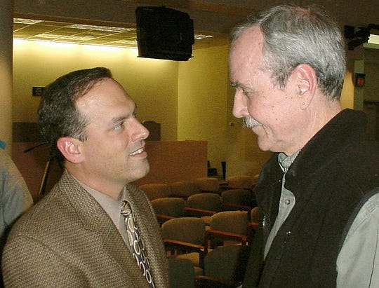 In this Dec. 2, 2002 file photo, then-Mayor Scott Maddox (left) talking with County Commissioner Bob Rackleff.