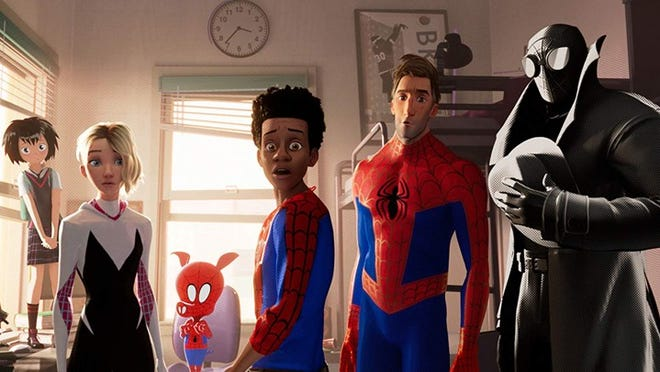 "Shameik Moore, center, is in mess of superheros in the animated action pic ""Spider-Man: Into the Spider-Verse,"" opening Friday."