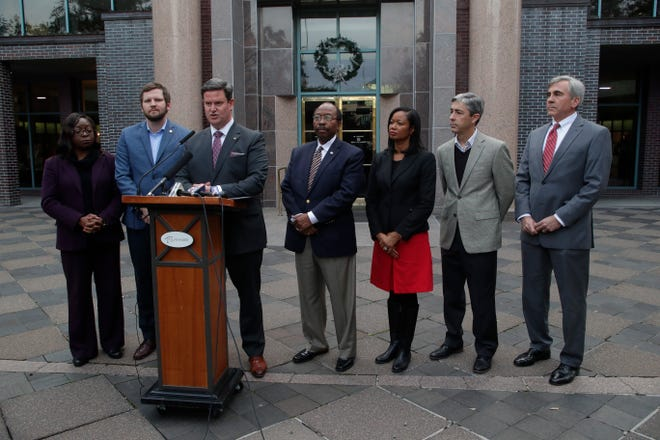 Surrounded by City Commissioners, Mayor John Dailey gives details on how the city will fill the vacancy of seat one in the City Commission after the suspension of Scott Maddox after he was indicted on federal charges Monday, Dec. 12, 2018.