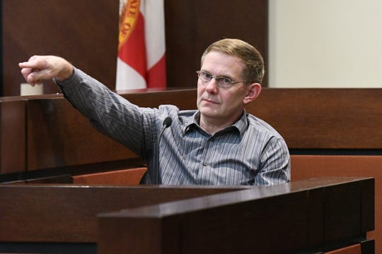 During the trial against Denise Williams for the murder of her husband Mike Williams, Nick Williams, Mike Williams' brother, points out Denise as the woman he is speaking about during his testimony, Wednesday, Dec. 12, 2018. Mike Williams was shot and killed by his best friend Brian Winchester on Dec. 16, 2000.