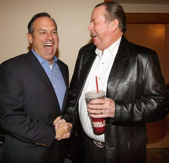 In this Jan. 5, 2011 file photo, Scott Maddox shakes hands with then-LCSO Sheriff Larry Campbell before a roast celebrating Campbell's 50 years in law enforcement.