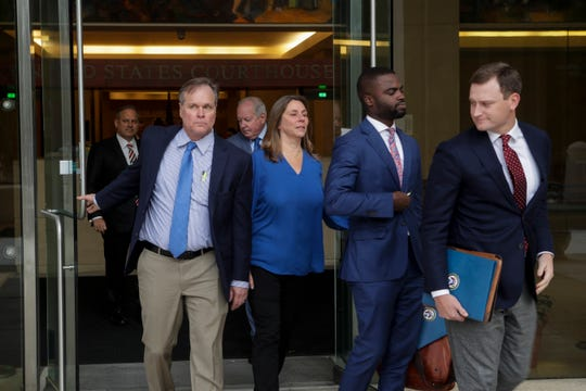 City Commissioner and former Mayor Scott Maddox, back left, and former Downtown Improvement Authority Executive Director Paige Carter-Smith, center, leave the U.S. Federal Court House in downtown Tallahassee with their attorneys after being indicted on federal charges Wednesday, Dec. 12, 2018.