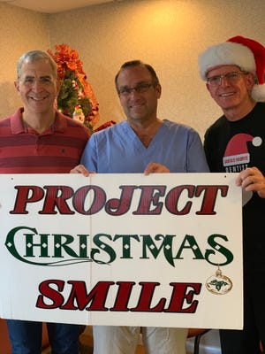 From left, Dr. Ronald Cusato, Dr. John Karpinski, and Dr. James Strawn gave  many patients a happy smile for Christmas.