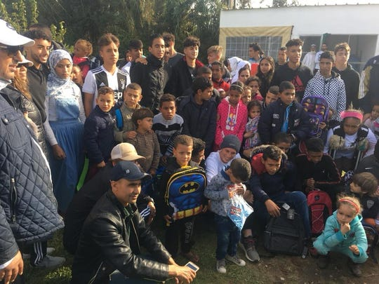 The U18 Port St. Lucie United soccer team distributes book bags and soccer jerseys to a local school in Rabat, the capital of Morocco, during their recent trip to the African nation.