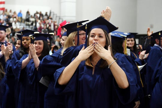 Isabella Hatcher, of Palm City, blows kisses to her friends and family on Wednesday, Dec. 2018, at the fall commencement ceremony for Indian River State College in Fort Pierce to thank them for their support as she worked her way through school.