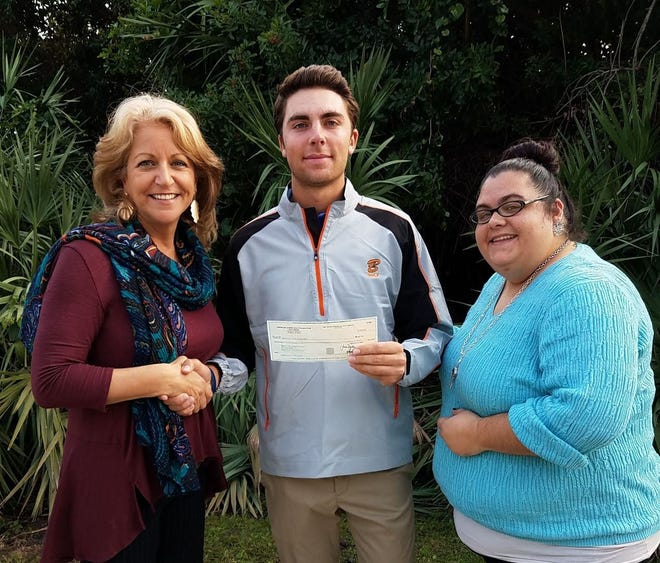 Alex Vogelsong, center, presents a check from the American Junior Golf Association to Theresa Woodson, left, American Cancer Society Senior Manager and Karen Aiello, right, Community Manager. Vogelsong raised the funds through participation in the AJGA Leadership Links program.