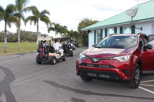 Santa's Sleigh and Hole-in-One sponsor's, Treasure Coast Toyota, car on display as the golfers head out to their holes.