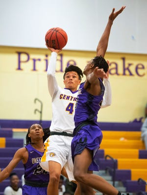 Fort Pierce Central's Isaiah Boria puts up a shot in the first half of their game against Okeechobee at Fort Pierce Central High School on Tuesday, December 11, 2018 in Fort Pierce.