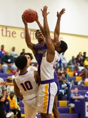 Okeechobee's Jemal Davis puts a shot up in the first half of their game against Fort Pierce Central at Fort Pierce Central High School on Tuesday, December 11, 2018 in Fort Pierce.