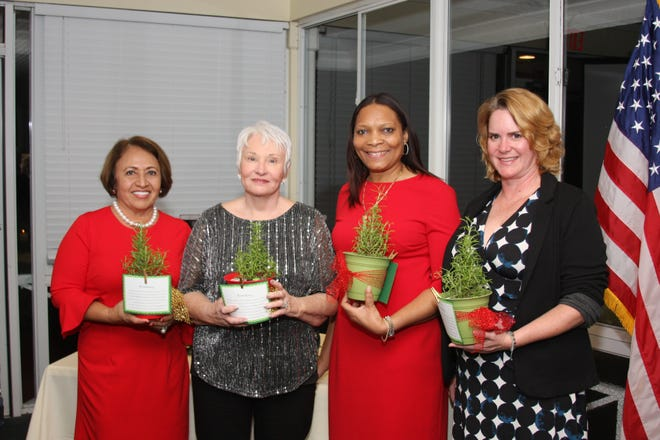 Incoming board members Treasurer Patricia King, Secretary Robbi Giaccone, President Angela Hayle and Vice President Donna DeMarchi were presented with potted rosemary plants.