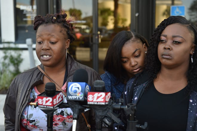 """Hydia Anderson, 22, (from left) older sister of fatal crash victim Alexis Chaney, speaks along Alexis's other sister Keyunzia Mills, 18, and their mother Shameka Baker, as they and their attorney John Phillips want an arrest in the Nov. 23rd accident that killed Chaney and four others along South 25th Street in Fort Pierce. """"We really need justice to be served,"""" Anderson said."""