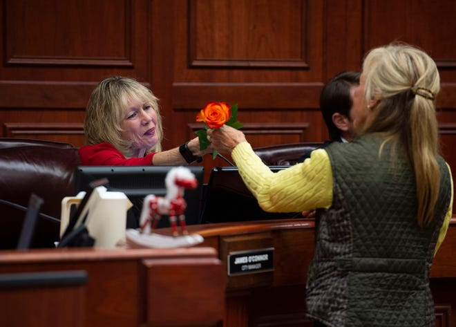 Debra Atwell (right), of Vero Beach, presents City Clerk Tammy Bursick with a rose in a show of support during a Vero Beach City Council meeting Tuesday, Dec. 11, 2018 at Vero Beach City Hall. Bursick was the focus of a special discussion requested by Councilman Dr. Val Zudans. Zudans was critical of how the clerk's office handled the Nov. 6 election and certification of City Council candidate Linda Hillman. Hillman sued the city after she was disqualified from November's election for having incomplete paperwork. In late November, the council agreed to hold a special election that will include six candidates, including Hillman and another disqualified candidate, Brian Heady.
