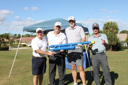 Florida Charity Golf Event's golf ball 'cannon.' Pictured left to right: Dan Capen of the Stuart Jet Center, Doug Campora, Incoming Board Chairman Ken Ringe of Bayview Construction, and Matt Launay