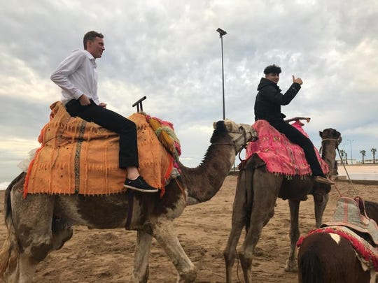 Members of the U18 Port St. Lucie United soccer team ride camels during their recent trip to Morocco.