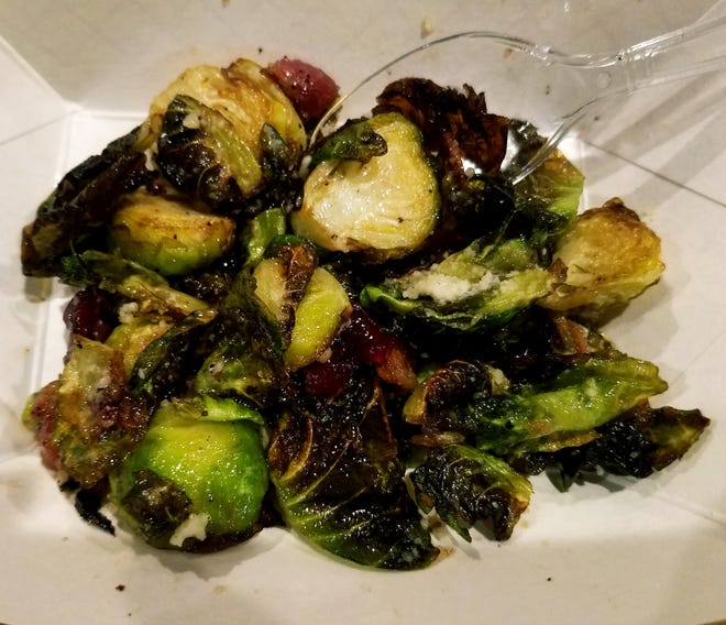The People's Choice Award at the Taste of Jensen went to Pineapple Jack's Bistro for its Brussel sprouts, flash-fried and tossed with bacon, chili agave, Pecorino and dried cranberries on Tuesday, Dec. 11, 2018.
