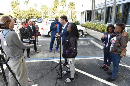 Jacksonville attorney John Phillips and family of Alexis Chaney, her mother Shameka Baker, and two sisters Hydia Anderson, 22, and Keyunzia Mills, 18, address the media during a press conference at the State Attorney's Office in Fort Pierce on Wednesday, Dec. 12, 2018. The family spoke about their call for justice, having 21-year-old Tanner Dashner arrested for causing the crash that killed Alexis Chaney and four others. Chaney, 17, was traveling as a passenger in a Dodge Dakota with five of her friends when they were rear-ended by 21-year-old Dashner, who was driving a 2004 GMC Yukon at a high rate of speed near Fort Pierce.  The vehicle Chaney was riding in burst into flames following the crash.