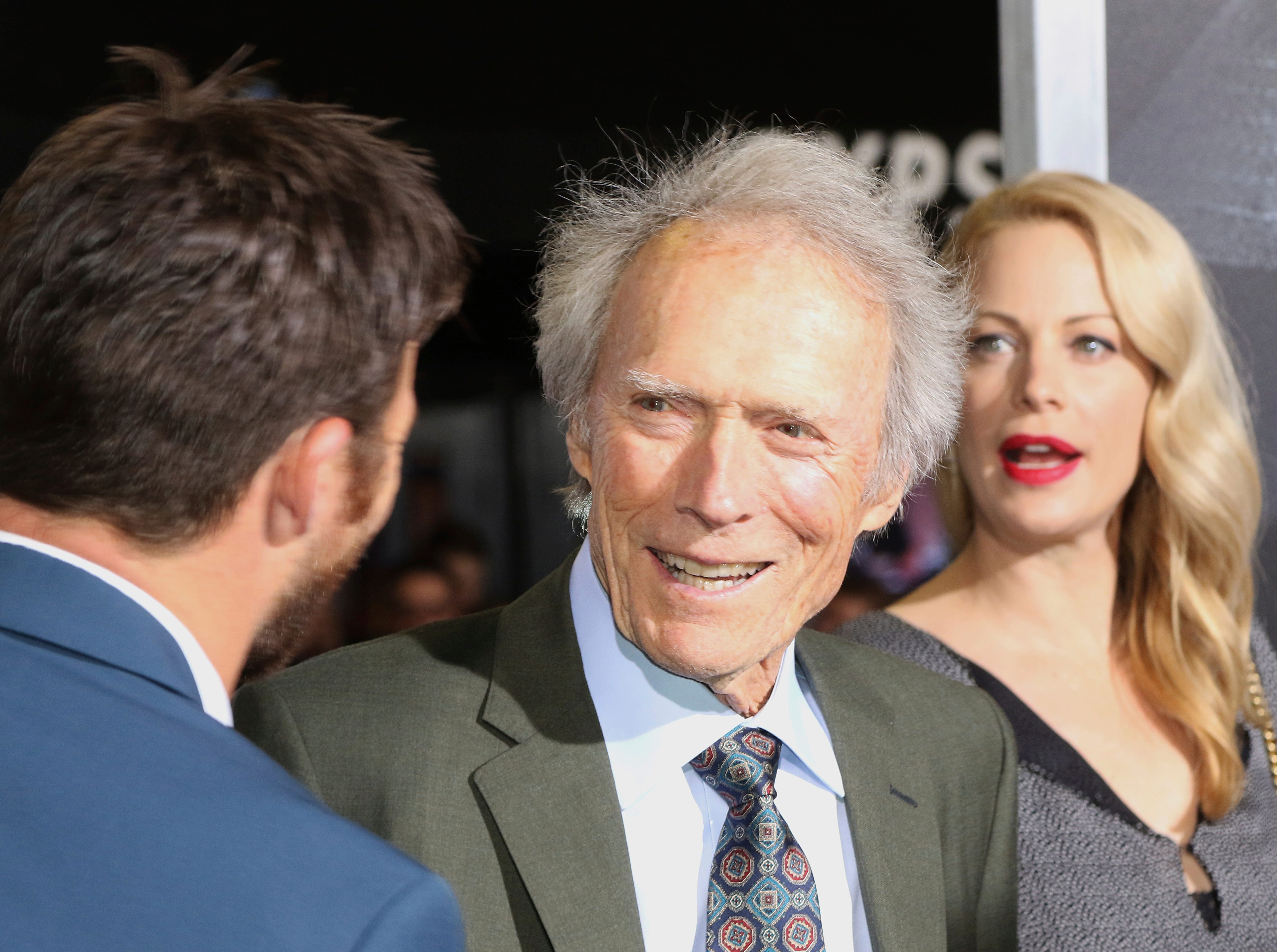 "Director/actor Clint Eastwood, center, son actor Scott Eastwood, left, and daughter actress Alison Eastwood arrive at the world premiere of ""The Mule"" on Monday, Dec. 10, 2018, at the Westwood Regency Village Theatre in Los Angeles."