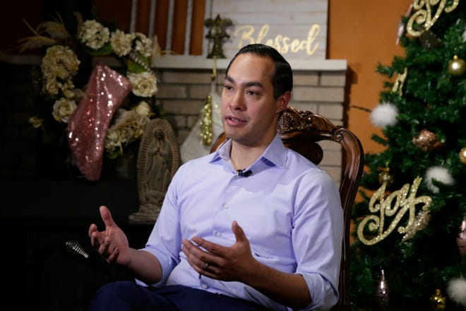 Democrat Julian Castro talks about exploring a run for president in 2020 at his home in San Antonio, on Tuesday, Dec. 11, 2018.  The announcement Wednesday gives the 44-year-old Castro a jump-start on what's likely to be a crowded Democratic primary field that has no clear front-runner. He tells The Associated Press he plans to announce his decision in early January.