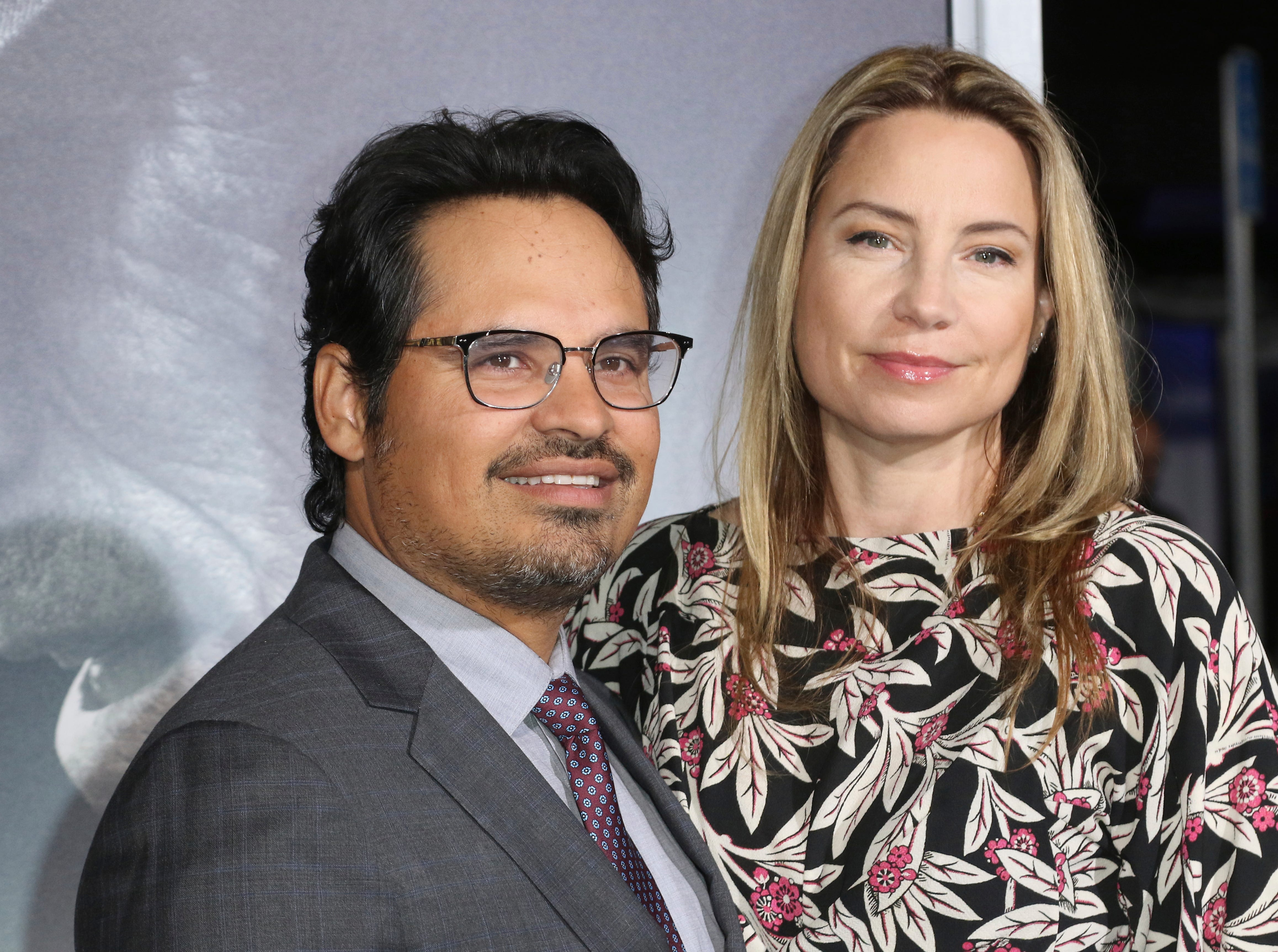 "Michael Pena, left, and Brie Shaffer arrive at the world premiere of ""The Mule"" on Monday, Dec. 10, 2018, at the Westwood Regency Village Theatre in Los Angeles."