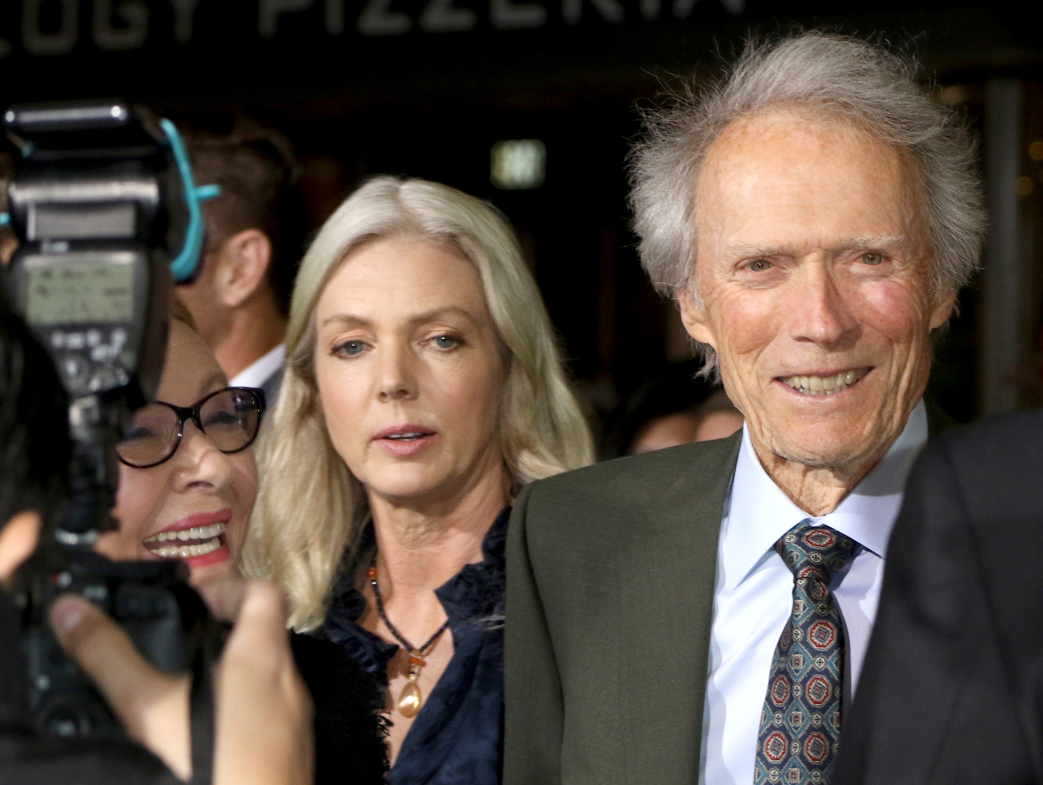 "Director/actor Clint Eastwood, from right, Christina Sandera and actress Dianne Wiest arrive at the world premiere of ""The Mule"" on Monday, Dec. 10, 2018, at the Westwood Regency Village Theatre in Los Angeles."