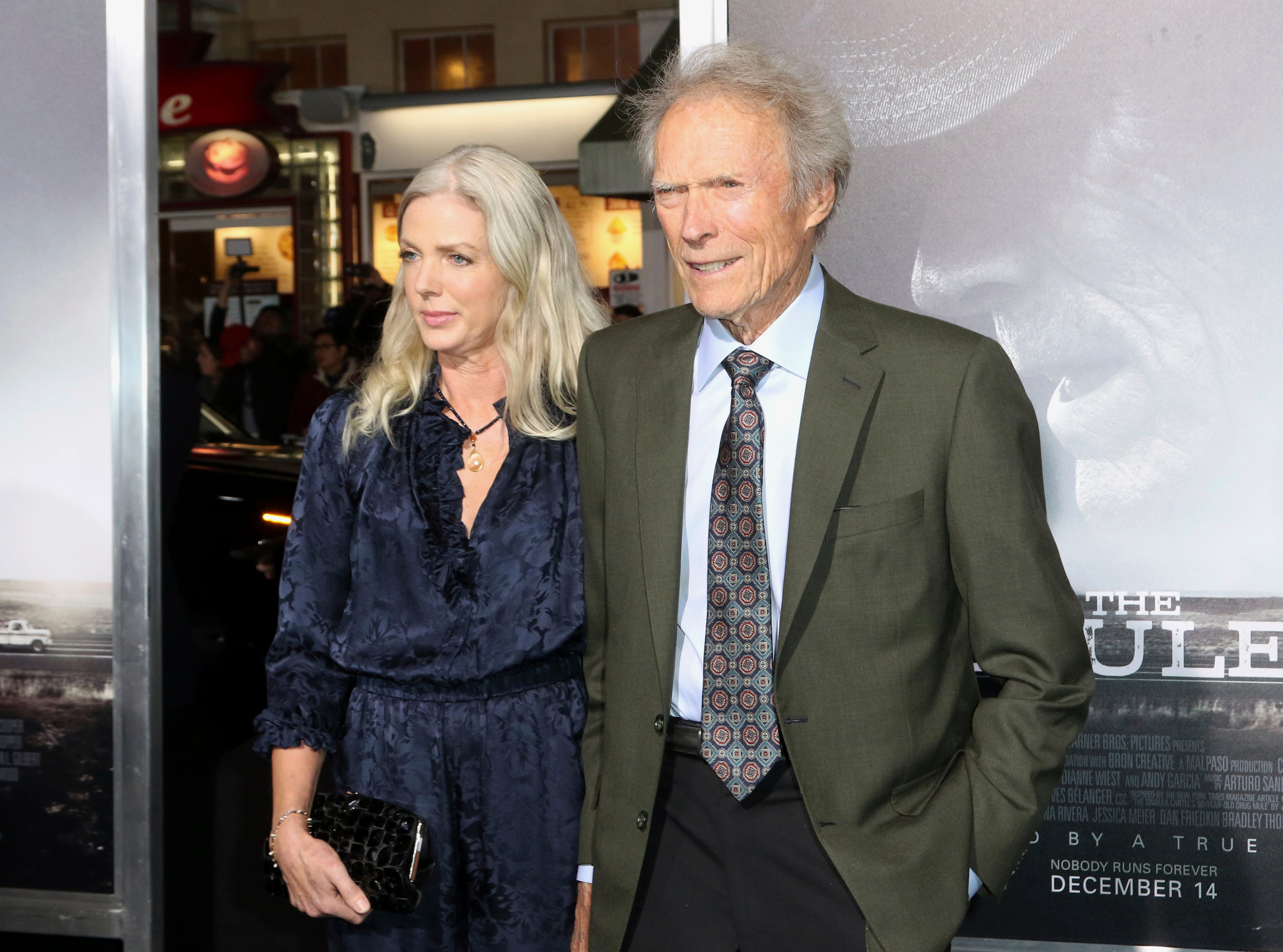 "Christina Sandera, left, and director/actor Clint Eastwood arrive at the world premiere of ""The Mule"" on Monday, Dec. 10, 2018, at the Westwood Regency Village Theatre in Los Angeles."