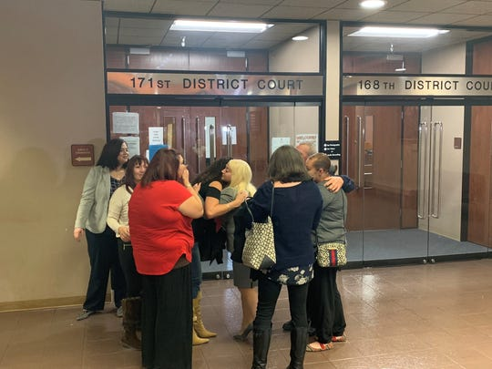 Family members of Raul Robles hug state prosecutor Ashley Martinez outside the 171st District Court after a guilty verdict of murder was handed down against Elizabeth Muñoz in Robles' death. Muñoz stabbed Robles with a tattoo gun.