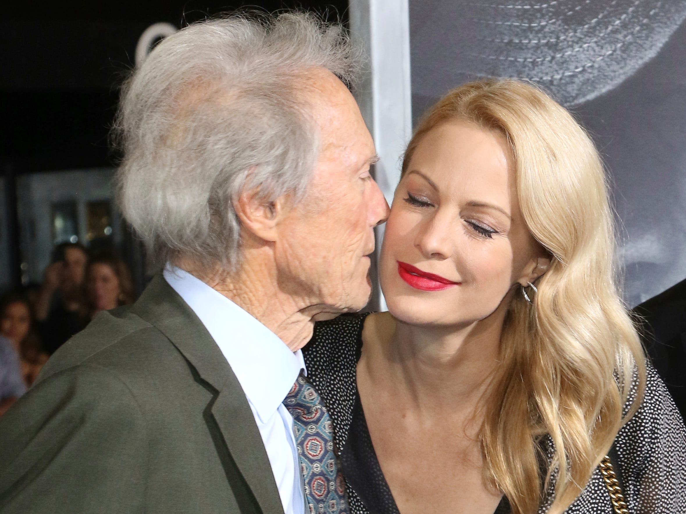 "Director/actor Clint Eastwood, left, kisses his daughter actress Alison Eastwood as they arrive at the world premiere of ""The Mule"" on Monday, Dec. 10, 2018, at the Westwood Regency Village Theatre in Los Angeles."