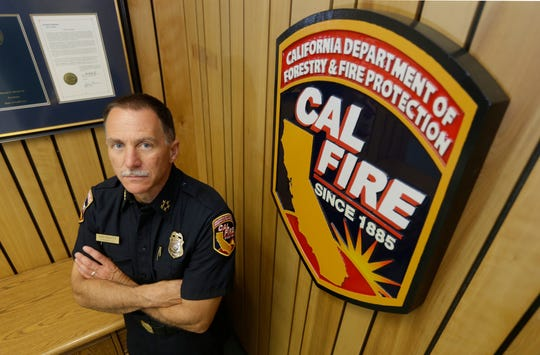 In this May 1, 2015, file photo, Ken Pimlott, director of the California Department of Forestry and Fire Protection poses in the agency headquarters in Sacramento.