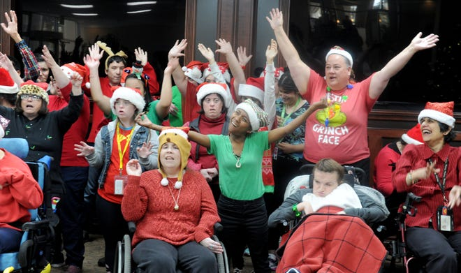 """The Arc of Ventura County choir performs """"Silent Night"""" at the Ventura Townehouse senior living center in Ventura on Wednesday. ARC, a nonprofit organization, aims to improve the quality of life for individuals with intellectual and developmental disabilities. The Arc choir has been performing since 2011."""