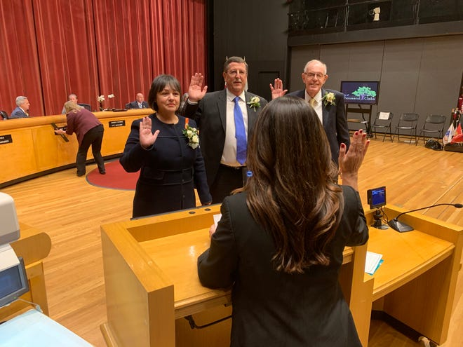 Thousand Oaks City Clerk Cynthia Rodriguez swears in City Council members Claudia Bill-de la Peña, Bob Engler and Ed Jones.