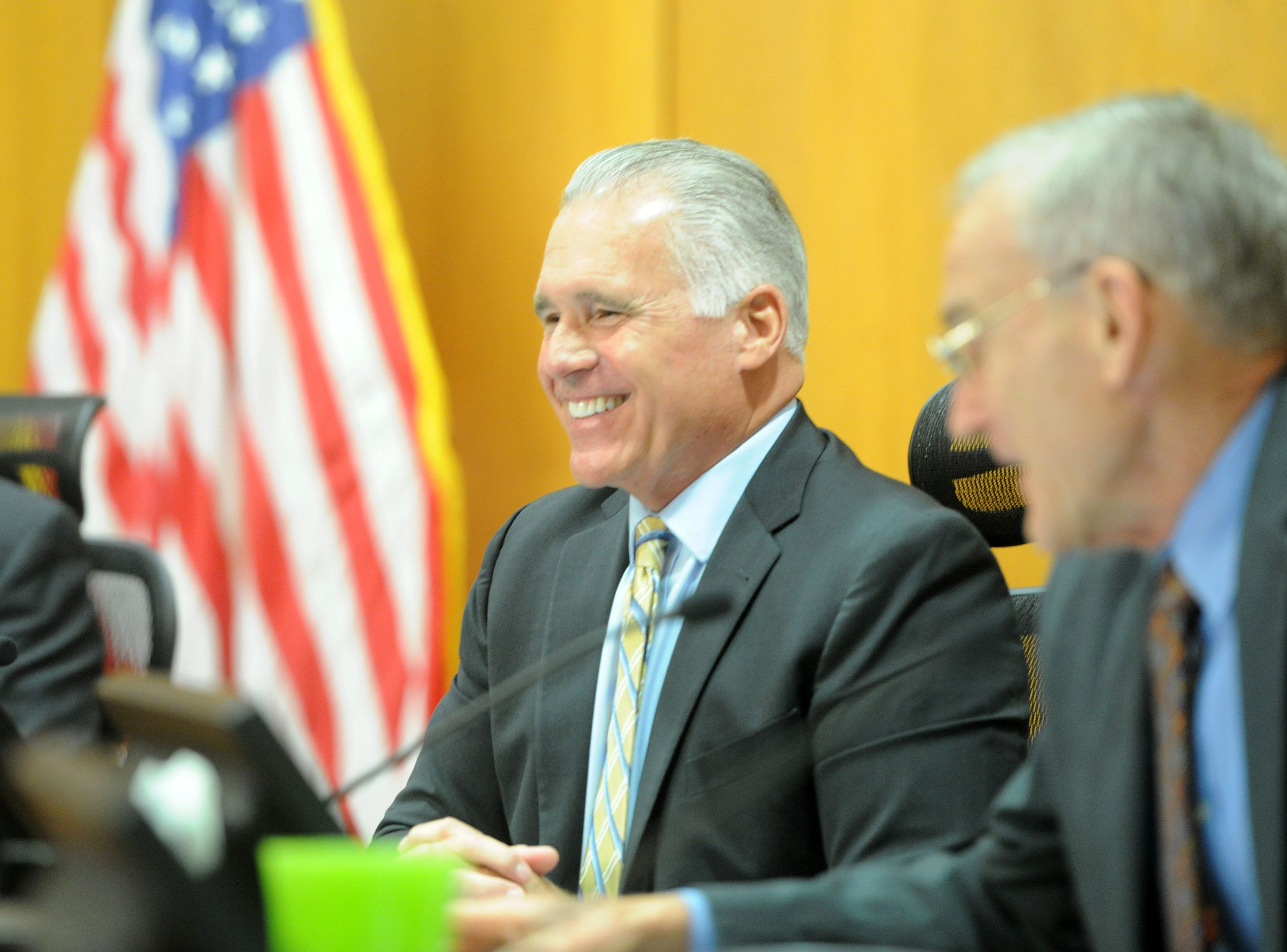 Supervisor Peter Foy smiles at the crowd attending a farewell ceremony for him at the Board of Supervisors hearing room in Ventura.