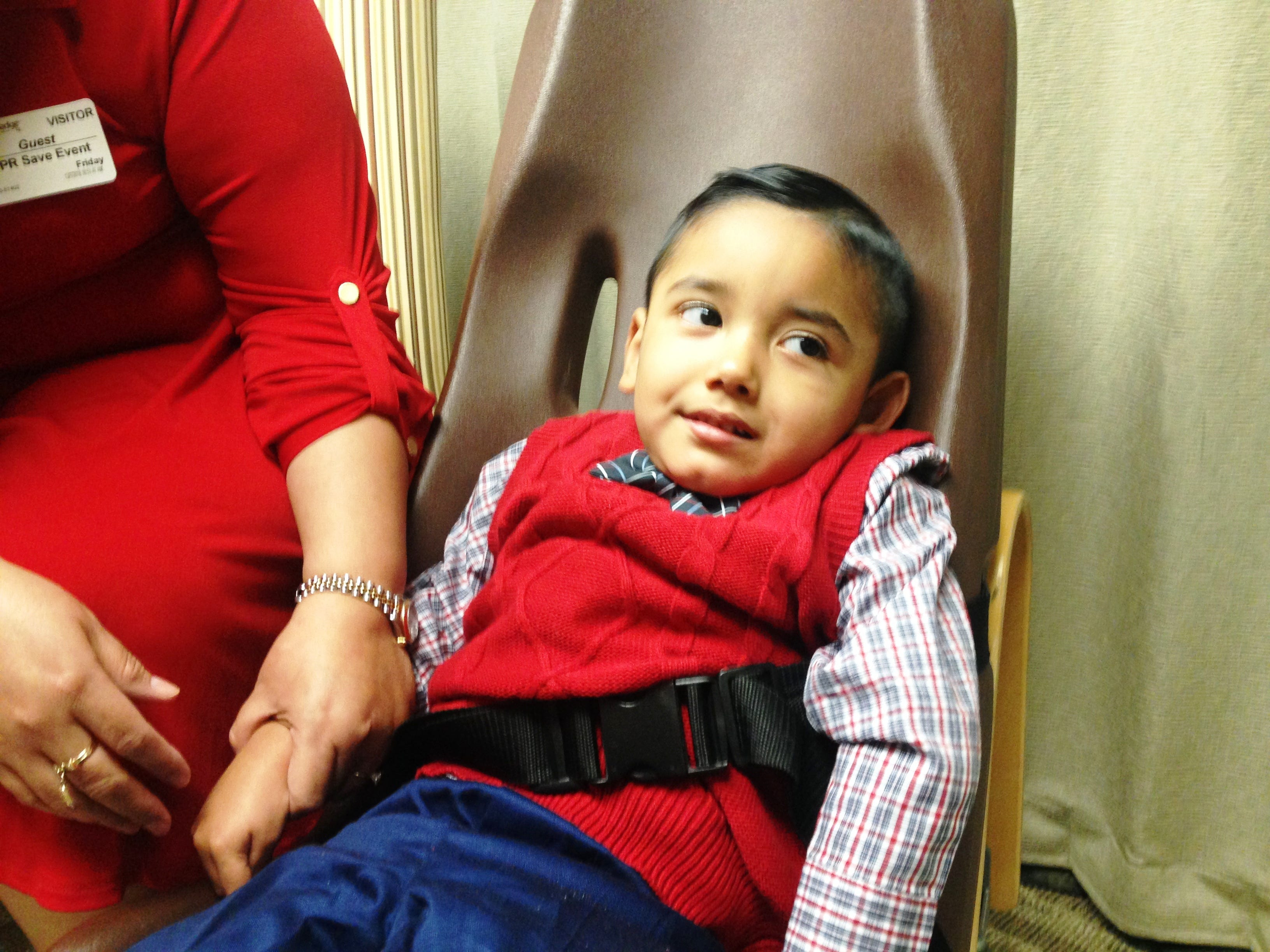 Sebastian Fernandez and his mother, Mireya Rodriguez, attend a first responders reunion on Dec. 7 at Adventist Health Simi Valley. The first responders are credited with saving the boy's life in December of 2013 when he fell into a pool in his backyard.