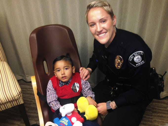 Rachel Stanley of the Simi Valley Police Department poses with Sebastian Fernandez at a reunion on Dec. 7 at Adventist Health Simi Valley. Stanley was among the team credited with saving Sebastian's life when he fell into a pool in December 2013.