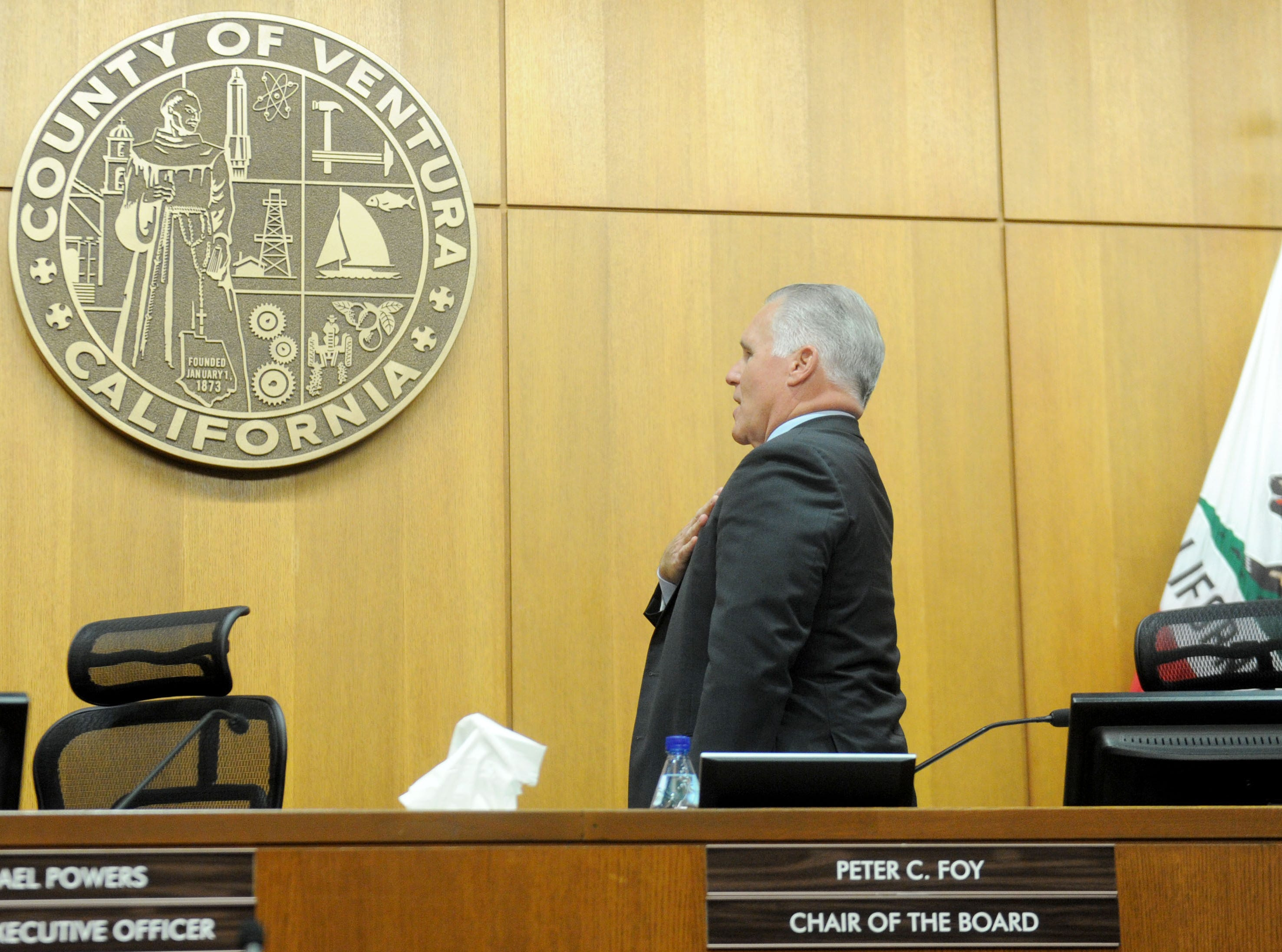 Supervisor Peter Foy leads the Pledge of Allegiance Tuesday at the Board of Supervisors meeting in Ventura. The occasion marked the last board meeting for Foy although his term does not end until Jan. 7.