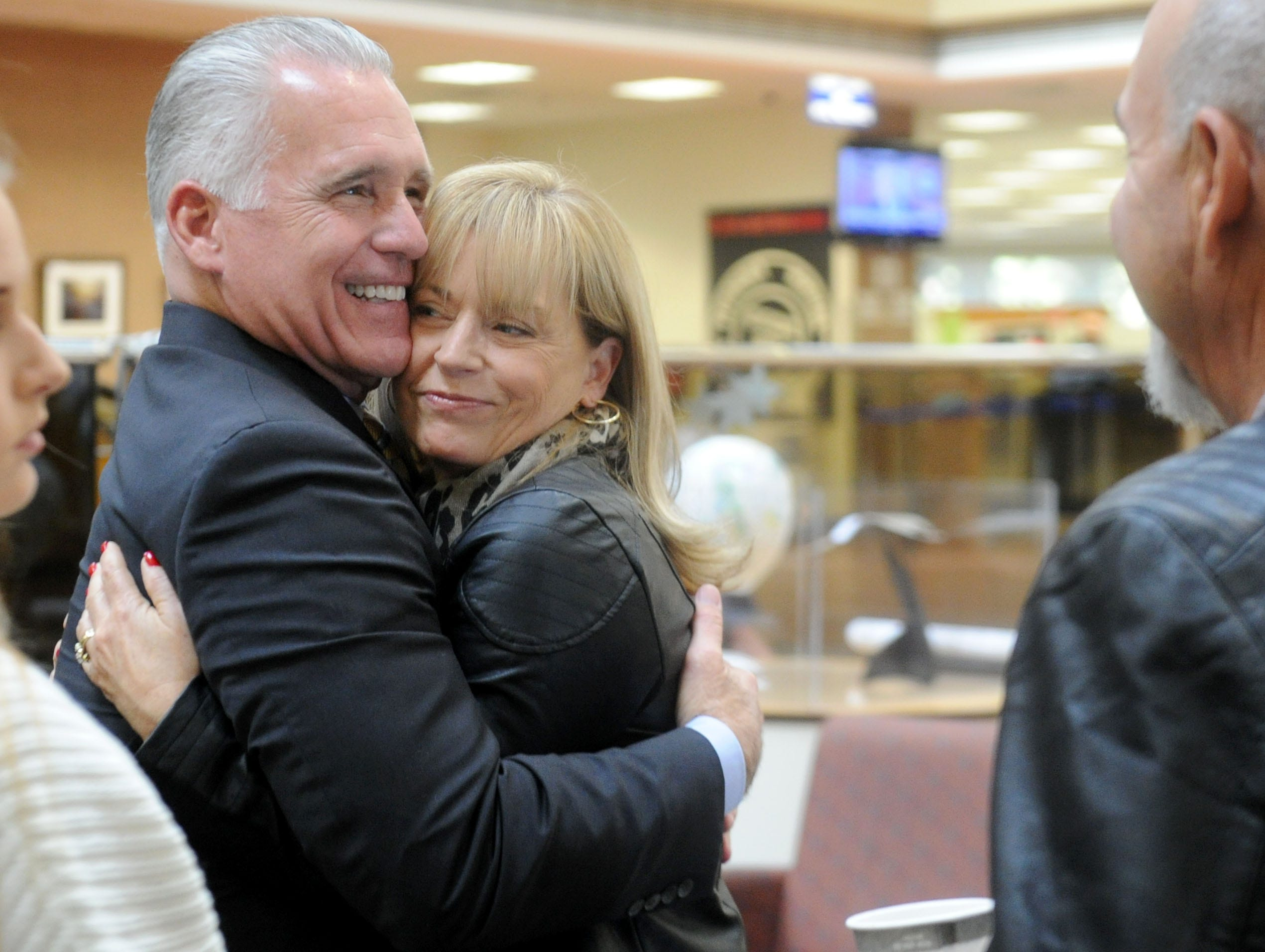 Supervisor Peter Foy hugs his wife Tara Foy at a going-away reception Tuesday outside the Board of Supervisors hearing room in Ventura.