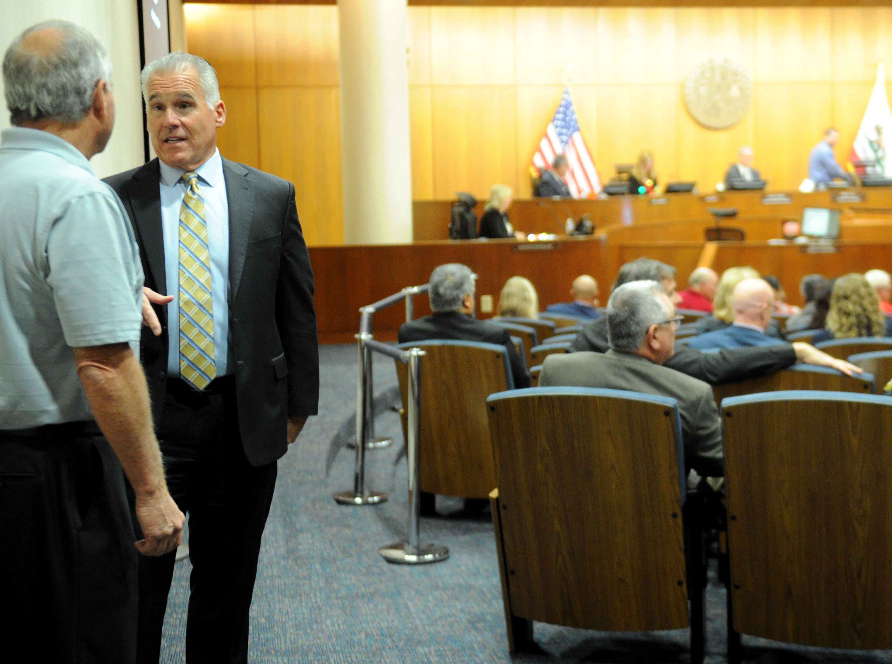 Ventura County Taxpayers Association President David Grau talks with Supervisor Peter Foy before his last meeting as a member of the Board of Supervisors.
