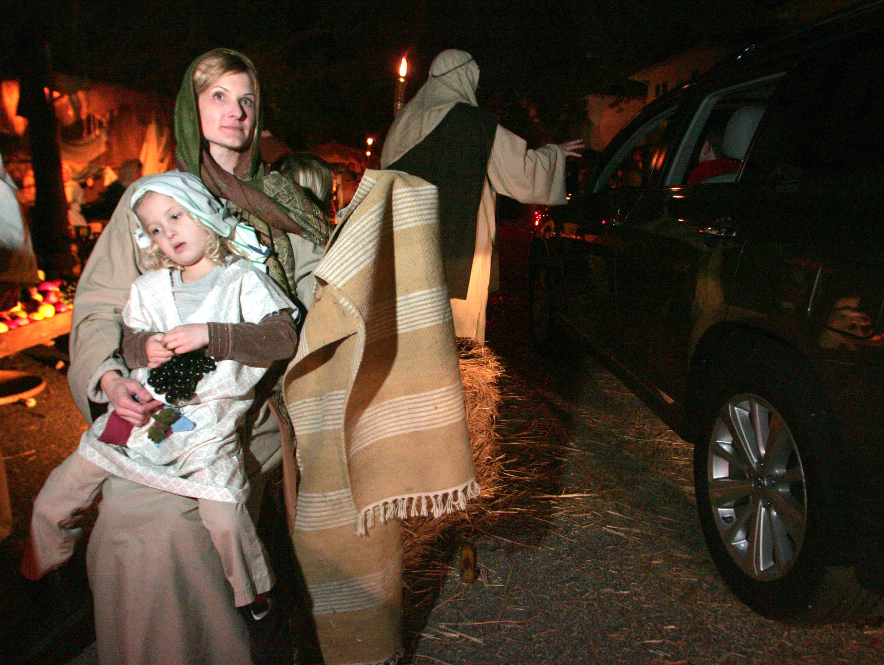 Volunteer actors Carrie Phillips holds her daughter Kennedy during the 2012 Bethlehem Experience.