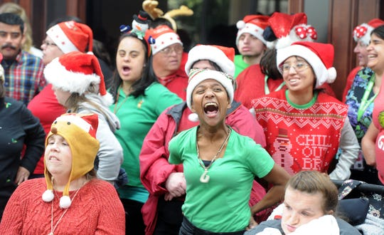 """Rosie Severns sings """" I Want to Wish You a Merry Christmas"""" with other members of The Arc of Ventura County choir Wednesday at the Ventura Townehouse in Ventura. Arc is a nonprofit organization dedicated to improving the quality of life for individuals with intellectual and developmental disabilities."""