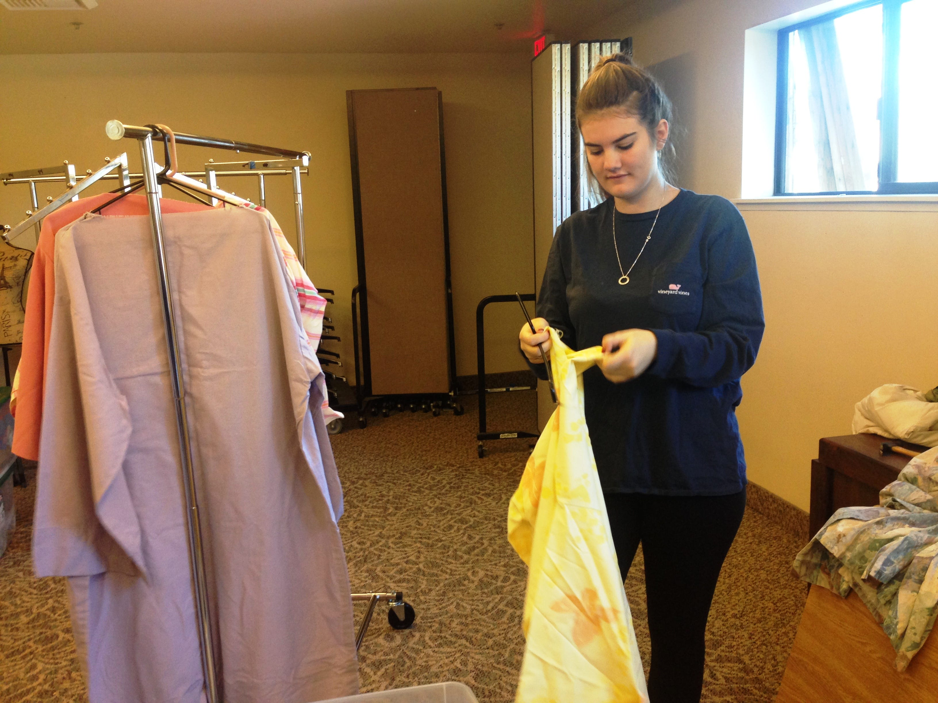 Chloe Nash sorts costumes for the Bethlehem Experience, a drive-through Nativity scene at Westminster Presbyterian Church in Westlake Village. This free event will take place from 5-9 p.m. Friday and Saturday.