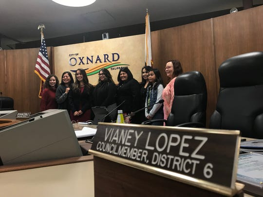 Councilwoman Vianey Lopez, third from left, poses with her supporters for a photo during a break in the City Council meeting.