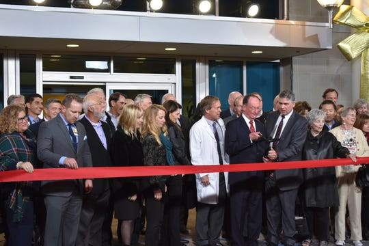 Hospital leaders prepare to cut the ribbon on the new Community Memorial Hospital in Ventura on Tuesday night.