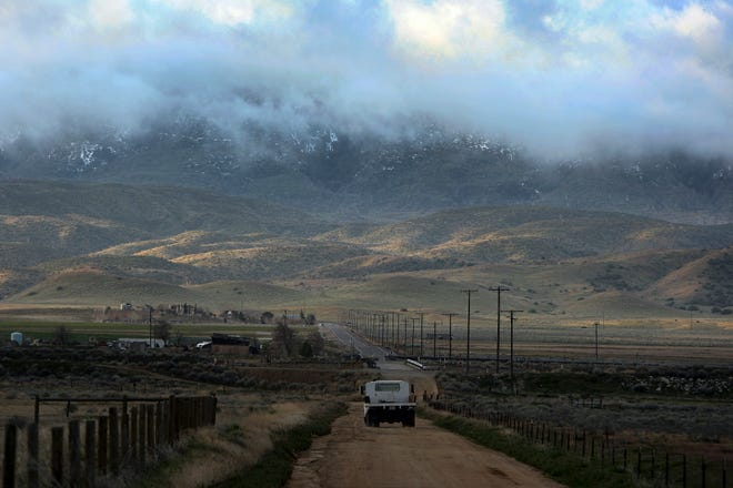 In March 26, 2011, file photo, threatening clouds are seen at sunrise on Tejon Ranch near Gorman. Los Angeles County supervisors cleared the way for a 19,000-home development there.