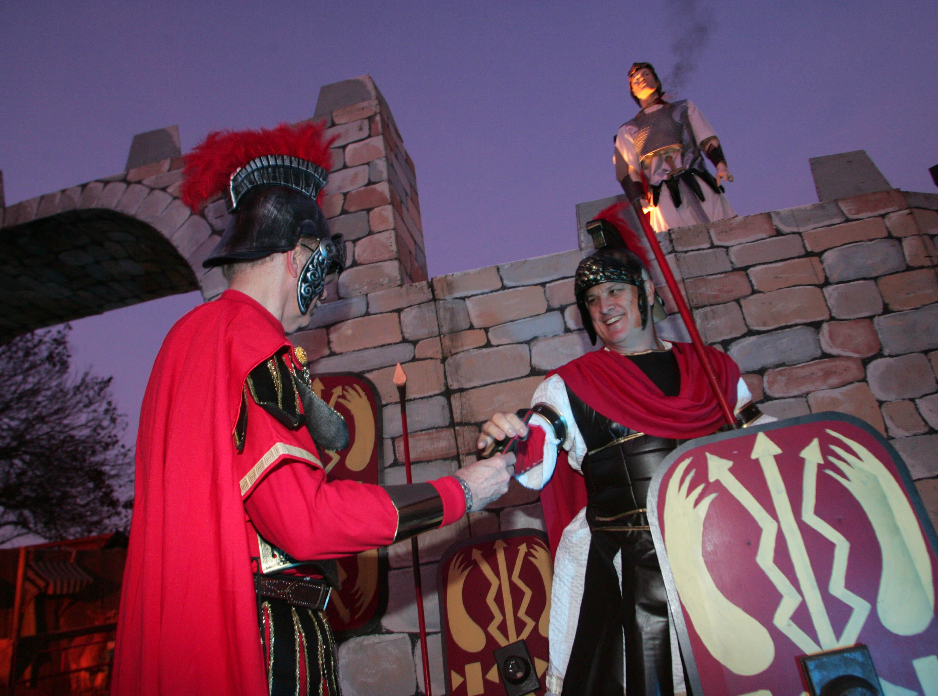 Ron Robinson, left, and Gary Rich, dressed as Roman centurions, take pictures of each other before the start of the 2012 Bethlehem Experience.