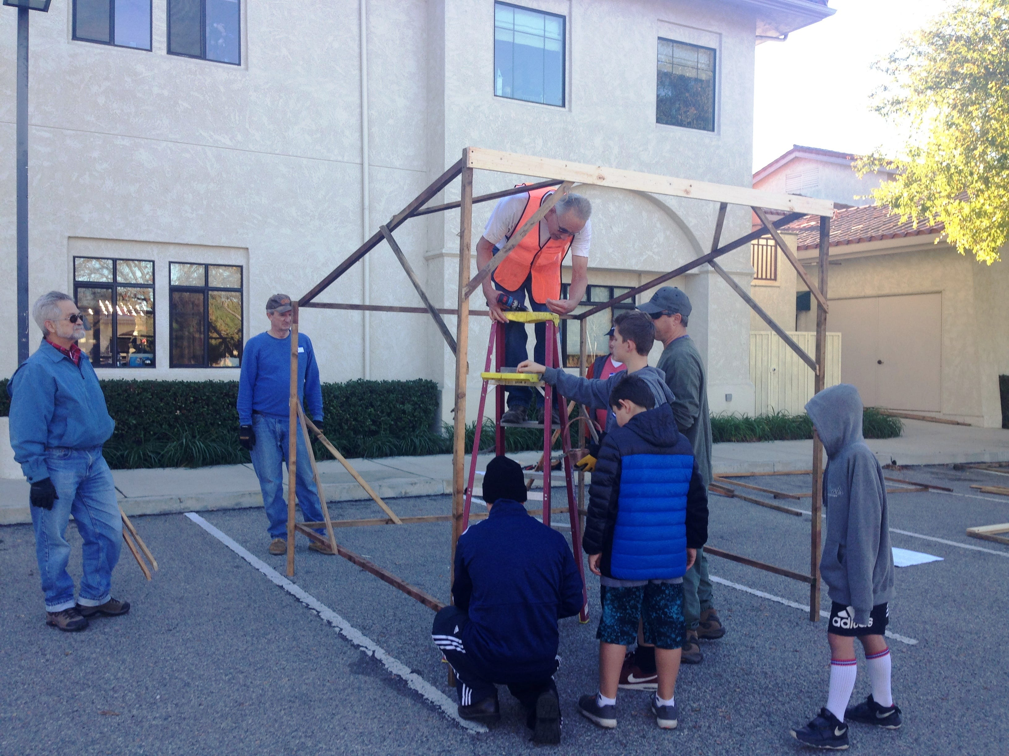 Volunteers build sets for the Bethlehem Experience, a drive-through Nativity scene at Westminster Presbyterian Church in Westlake Village. This free event will take place from 5-9 p.m. Friday and Saturday.
