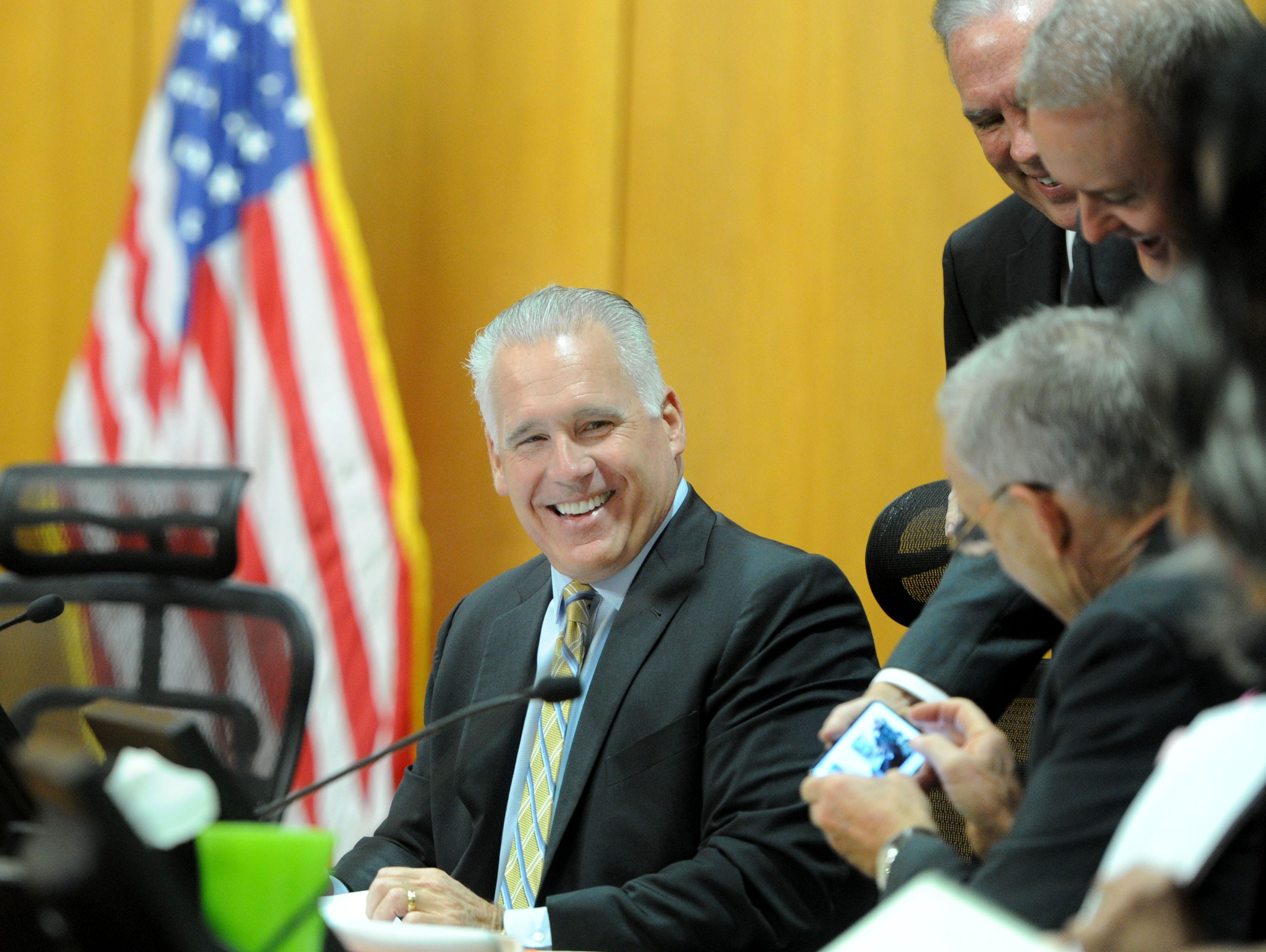 Supervisor Peter Foywatches as County Executive Officer Mike Powers shares a photo at the last meeting during Foy's tenure on the Board of Supervisors.