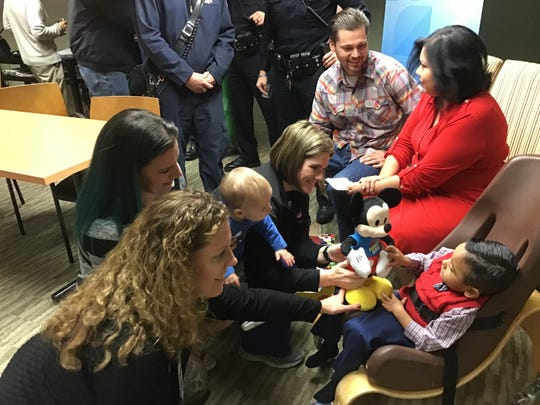First responders meet Mireya Rodriguez and her son Sebastian Fernandez.