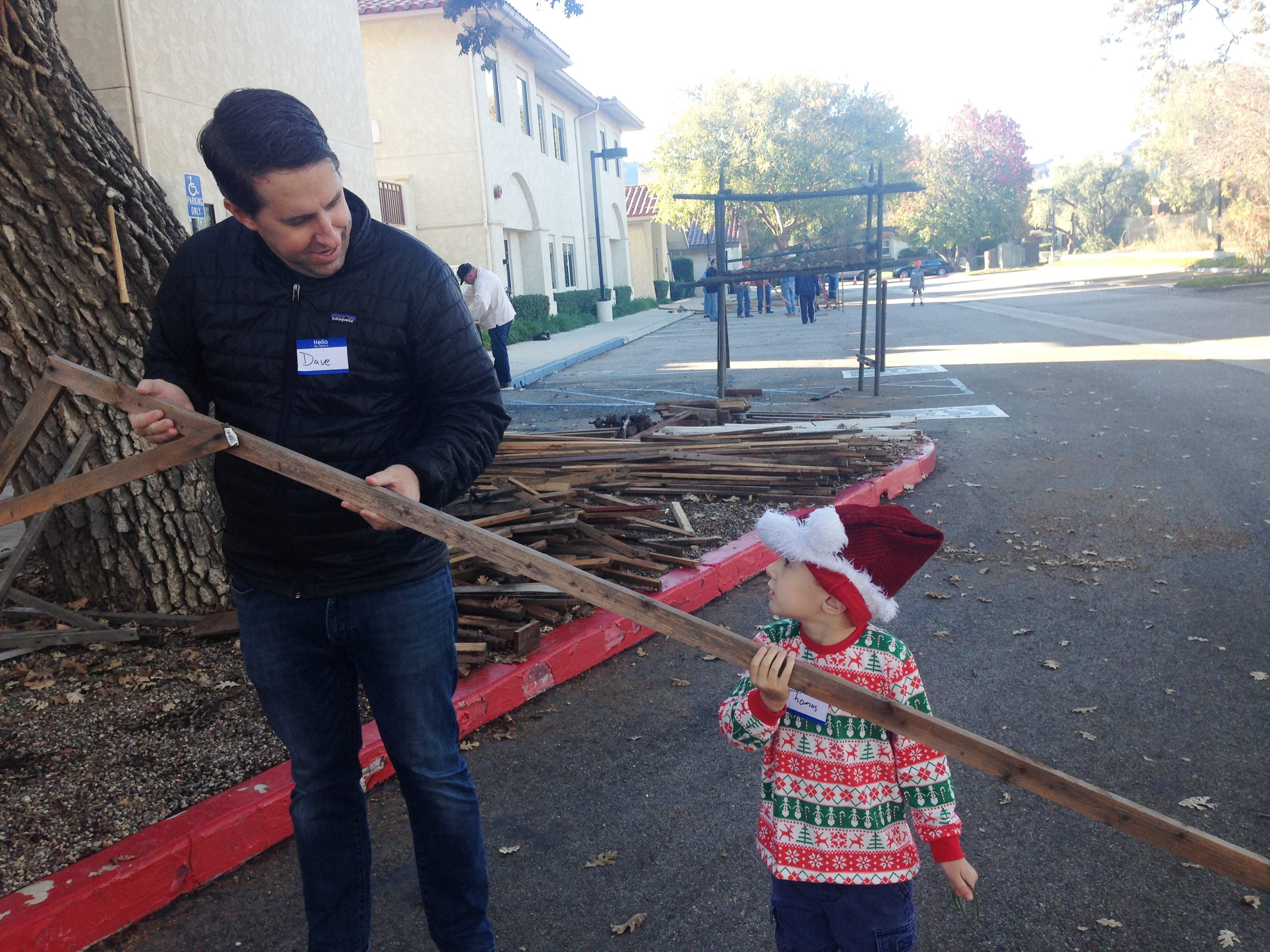Dave Rohde, pastor at Westminster Presbyterian Church, and his 3-year-old son, Thomas, help build the Bethlehem Experience, a drive-through Nativity scene at Westminster Presbyterian Church in Westlake Village. This free event will take place from 5-9 p.m. Friday and Saturday.