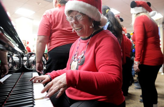 """Trieana Moon plays the piano as The Arc of Ventura County choir sings """"Rudolph the Red-Nosed Reindeer"""" on Wednesday at the Ventura Townehouse in Ventura."""