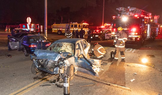 Two people were transported to a local hospital with moderate to major injuries after a collision between three cars on Noble Avenue at McAuliff Street on Tuesday, December 11, 2018. A stolen Honda, right, one of two cars traveling east at high speeds, struck a third car stopped at the stop sign. The second car struck the Honda immediately afterward. The driver from the Honda was pinned in until firemen could get him out and is suspected of driving under the influence. Occupants of the Honda were all juveniles. Visalia Police are investigating the cause and relationships between occupants of the speeding cars.