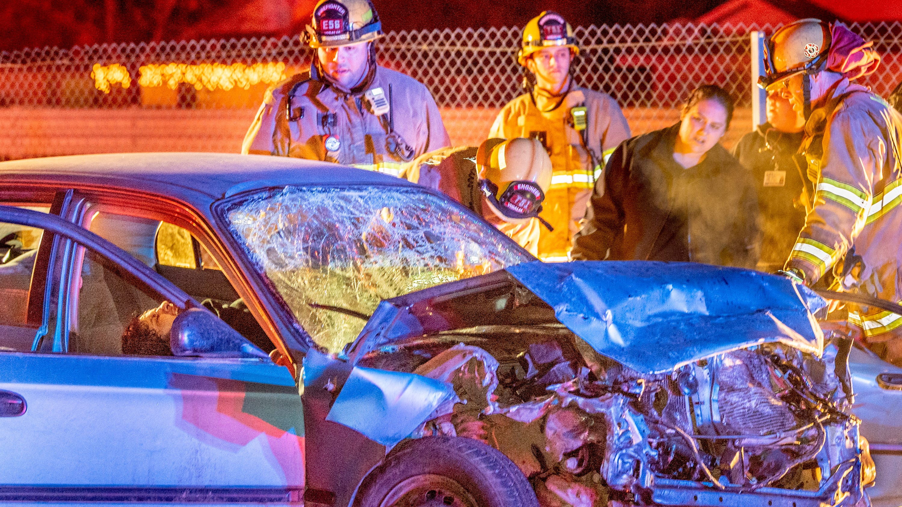 Two people were transported to a local hospital with moderate to major injuries after a collision between three cars on Noble Avenue at McAuliff Street on Tuesday, December 11, 2018. A stolen Honda, one of two cars traveling east at high speeds, struck a third car stopped at the stop sign. The second car struck the Honda immediately afterward. The driver from the Honda, left, was pinned in until firemen could get him out and is suspected of driving under the influence. Occupants of the Honda were all juveniles. Visalia Police are investigating the cause and relationships between occupants of the speeding cars.